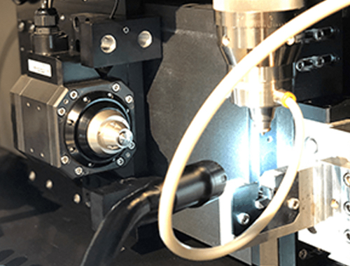 Laser Beam Delivery and Focusing Optics - Maintaining Yield When Microwelding